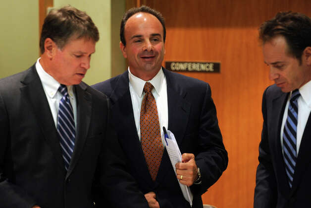 Former Bridgeport Mayor Joseph Ganim, center, and his attorneys Harold Rosnick, left, and George Ganim, right, in Bridgeport, Conn. Sept. 11th, 2012. Ganim appeared in front of a three judge panel Tuesday in his effort to regain his law license. He was convicted in 2003 of federal corruption, and served seven years of a nine year sentence. Photo: Ned Gerard / Connecticut Post