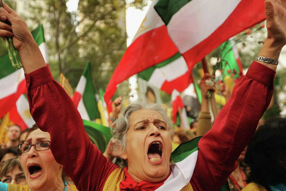 NEW YORK, NY - SEPTEMBER 26:  People attend a rally of groups opposing Iranian President Ahmadinejad?s speech at the United Nations General Assembly on September 26, 2012 in New York City. Politicians including former New York Mayor Rudolph Giuliani, former House Speaker Newt Gingrich, former Homeland Security Secretary Tom Ridge, former New Mexico Governor Bill Richardson and former U.N Ambassador John Bolton spoke at the pro-democracy rally which also included Syrian pro-democracy protesters. Photo: Mario Tama, Getty Images / 2012 Getty Images