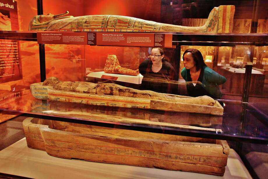 This is the mummy and sarcophagus of an Egyptian Priest named Nes-pa-kai-schuti, who played a role in the Egyptian religious hierarchy 2,650 years ago. The sarcophagus is made from sycamore wood and decorated with detailed paintings. Beautiful and extensive hieroglyphics tell us his name, his family heritage and his occupation. The inner coffin illustrates stages of the dead man's journey into the afterlife. Photo: Darryl Moran, Courtesy
