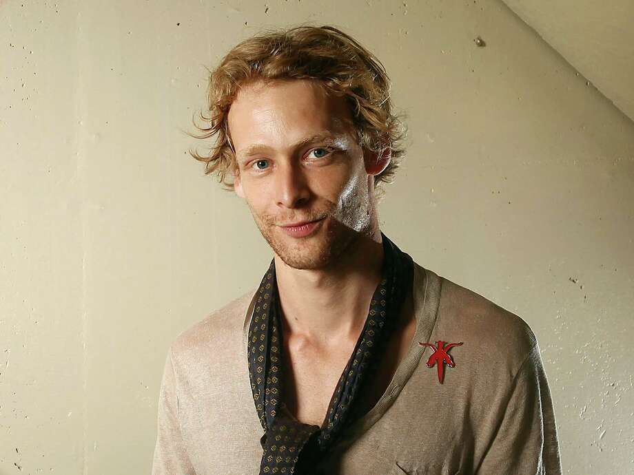 Johnny Lewis Authorities say the late 'Sons of Anarchy' star fell to his death after killing his elderly landlady in Los Angeles in 2012. Photo: Carlo Allegri, Associated Press / R-Allegri