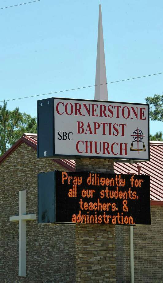Signs around Kountze could be seen Thursday afternoon.  A temporary restraining order was filed against the Kountze school district at the Hardin County courthouse Thursday afternoon and a hearing with District Judge Steve Thomas happened right afterwards. Parents are suing on behalf of the cheerleaders after the district banned the cheerleaders from using signs and banners with scripture verses on them at football games.   Dave Ryan/The Enterprise Photo: Dave Ryan