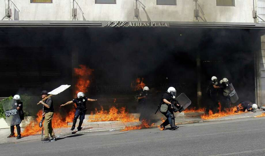 GREECE , ATHENS - SEPTEMBER 26: Police are tageted with molotov cocktails during a 24-hour labour strike September 26, 2012 in Athens. Today marks Greece's first big anti-austerity strike since the coalition government took power in June.  (Photo by Milos Bicanski/Getty Images) *** BESTPIX *** Photo: Milos Bicanski, Getty Images / 2012 Getty Images