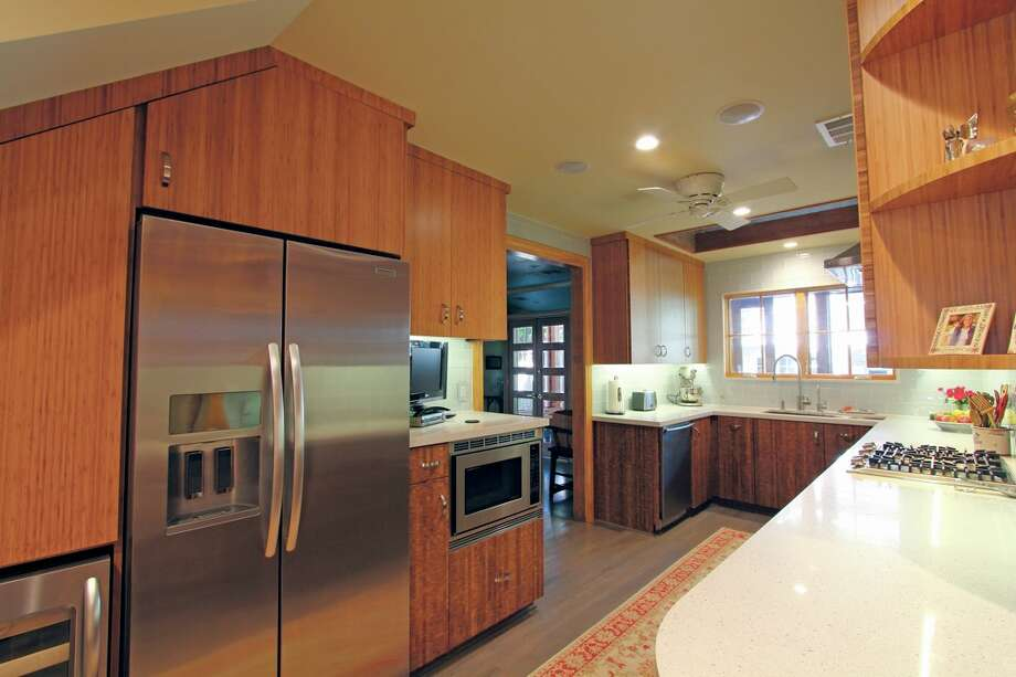 This contemporary kitchen was remodeled by Houston Remodelors Council member, John Gillette, owner of Craftsmanship by John.