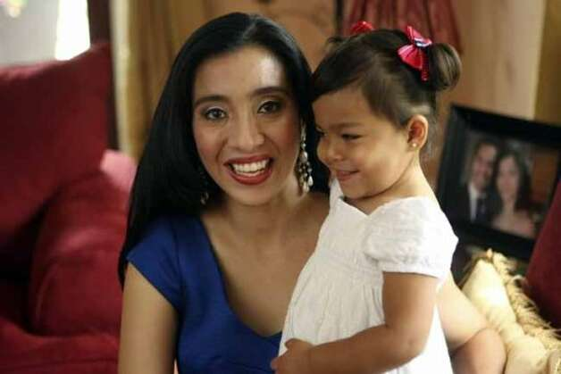 Erica Castro and her daughter Carina , 2. Erica is a working mom who is a math specialist for NISD. HELEN L. MONTOYA/hmontoya@conexionsa.com (SAN ANTONIO EXPRESS-NEWS)