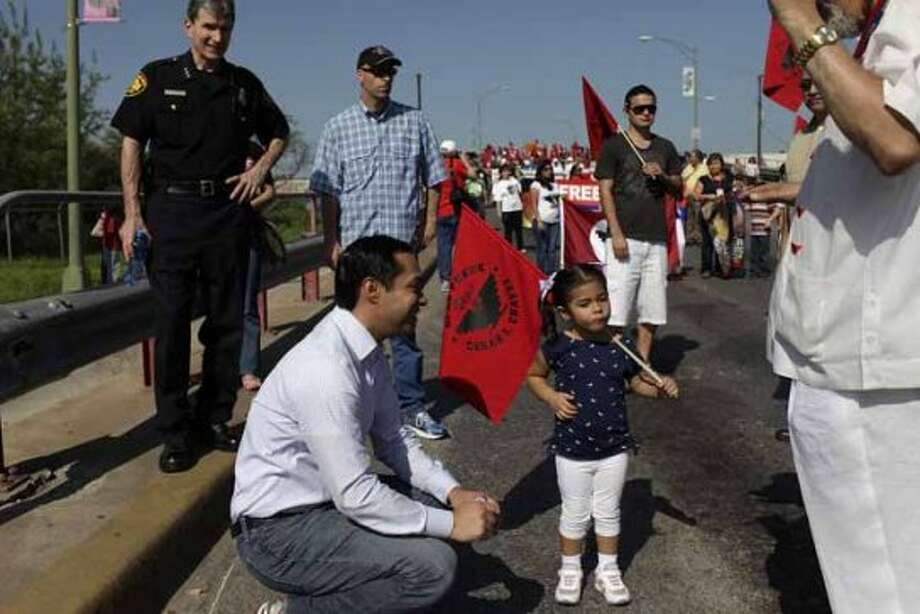 metro - Mayor Julian Castro makes sure his daughter, Carina Castro, 3, stays hydrated during the Cesar E. Chavez March for Justice in San Antonio on Saturday, March 31, 2012. LISA KRANTZ/San Antonio Express-News (SAN ANTONIO EXPRESS-NEWS)