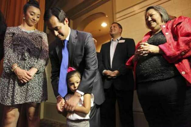 Mayor Julian Castro (center) hugs his daughter Carina, 3, as his wife Erica Castro (left) and his mom Rosie Castro look on before taking the stage with his twin brother congressional candidate Joaquin Castro (not pictured) at a welcome home and birthday party celebration held Monday Sept. 10, 2012 at Sunset Station. The twins will be 38-years-old on Sept. 16. (San Antonio Express-News)