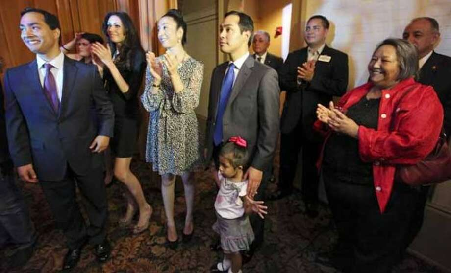 Congressional candidate Joaquin Castro (from left) his girlfriend Anna Flores, Erica Castro, Mayor Julian Castro their daughter Carina, 3, and the twins mom Rosie Castor wait to take the stage during a welcome home and birthday party celebration held Monday Sept. 10, 2012 at Sunset Station. The twins will be 38-years-old on Sept. 16. (San Antonio Express-News) Photo: San Antonio Express-News