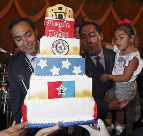 Congressional candidate Joaquin Castro (left) and his twin brother Mayor Julian Castro with his daughter Carina, 3, blow out candles on a cake during a welcome home and birthday party celebration held Monday Sept. 10, 2012 at Sunset Station. The twins will be 38-years-old on Sept. 16. (San Antonio Express-News)