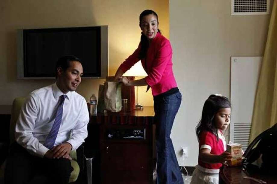 Mayor Julian Castro takes a break from rehearsing his keynote speech with his wife, Erica Castro, and their daughter, Carina, 3, in their hotel room a few hours before the start of the Democratic National Convention in Charlotte, NC on Tuesday, Sept. 4, 2012. (San Antonio Express-News)