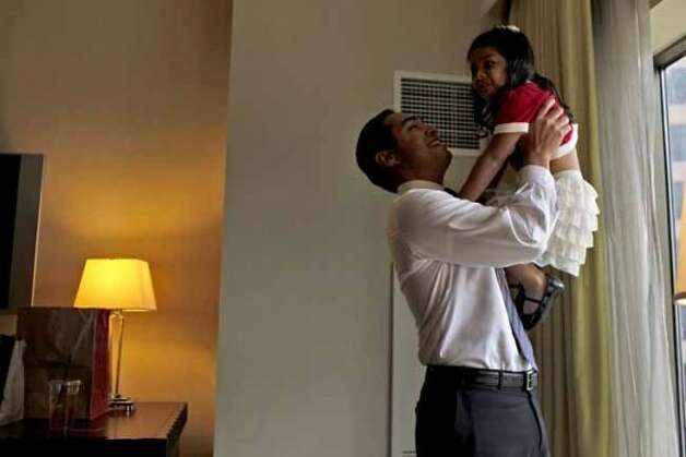 Mayor Julian Castro takes a break with his daughter, Carina, 3, in their hotel room as he prepares for his keynote speech during the Democratic National Convention in Charlotte, NC on Tuesday, Sept. 4, 2012. (San Antonio Express-News)
