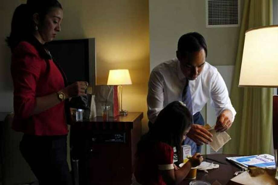 Mayor Julian Castro takes a lunch break with his wife, Erica Castro, and their daughter, Carina, 3, in their hotel room as he prepares for his keynote speech during the Democratic National Convention in Charlotte, NC on Tuesday, Sept. 4, 2012. (San Antonio Express-News)