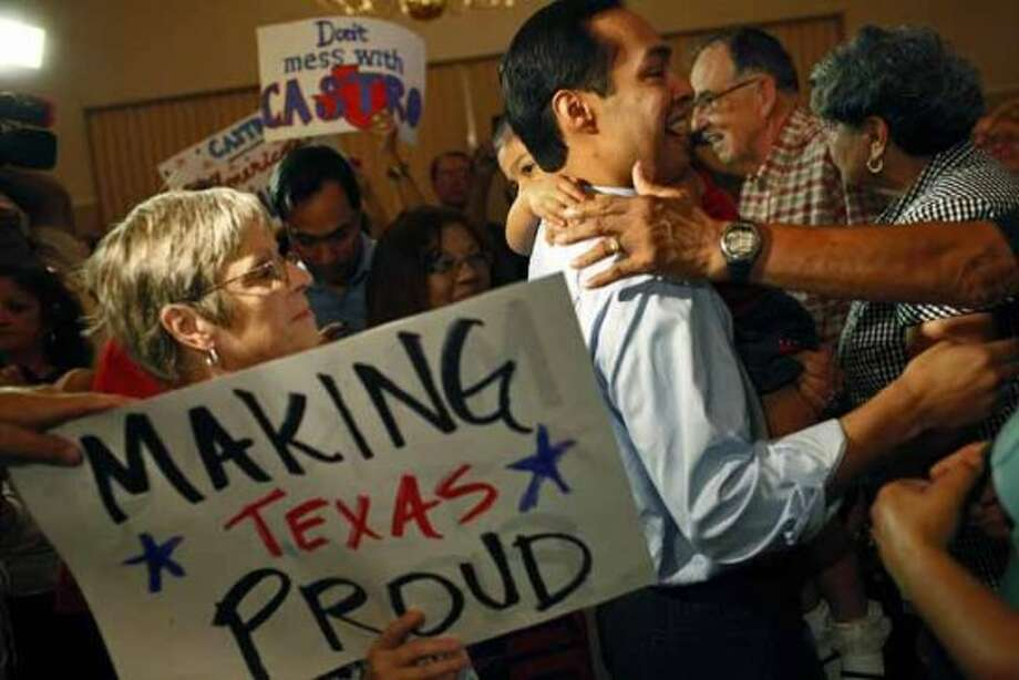 Mayor Julian Castro, holding his daughter, Carina, 3, is surrounded by supporters at the send-off party for his trip to the Democratic National Convention at the St. Paul Community Center in San Antonio on Saturday, Sept. 1, 2012. (San Antonio Express-News)
