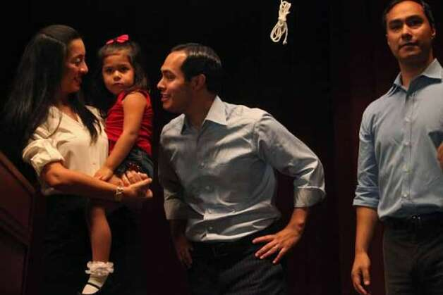 Mayor Julian Castro, center, stands with his wife, Erica Castro, their daughter, Carina, 3, and his brother, Joaquin Castro, right, on stage during the send-off party for their trip to the Democratic National Convention at the St. Paul Community Center in San Antonio on Saturday, Sept. 1, 2012. (San Antonio Express-News)