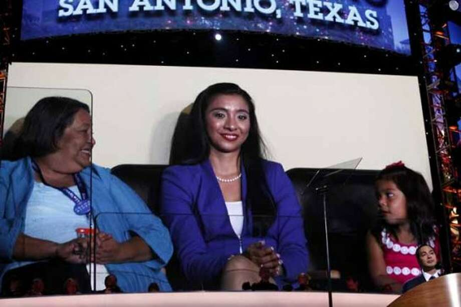 Rosie Castro, the mother of Mayor Julian Castro, his wife, Erica Castro and their daughter, Carina, 3, are shown in their seats on the video screen behind him as he gives the keynote address on the first night of the Democratic National Convention at Time Warner Cable Arena in Charlotte, NC on Tuesday, Sept. 4, 2012. (San Antonio Express-News)