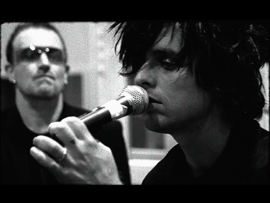 Green Day, 2006: Bono and Billie Joe Armstrong in the studio together working on the joint charity single, 'When The Saints Go Marching In.'