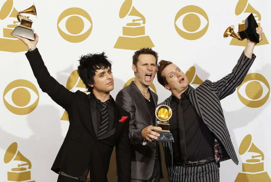 Green Day, 2010: Green Day members pose backstage with their awards for best rock album for '21st Century Breakdown' at the 52nd annual Grammy Awards in Los Angeles.