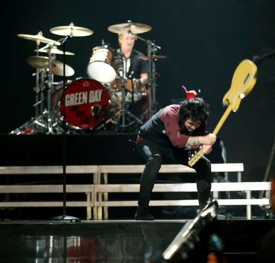 Green Day, 2012: Billie Joe Armstrong smashes his guitar after the band's set is cut short during the iHeartRadio Music Festival at the MGM Grand Garden Arena in Las Vegas. Photo: Christopher Polk / 2012 Getty Images