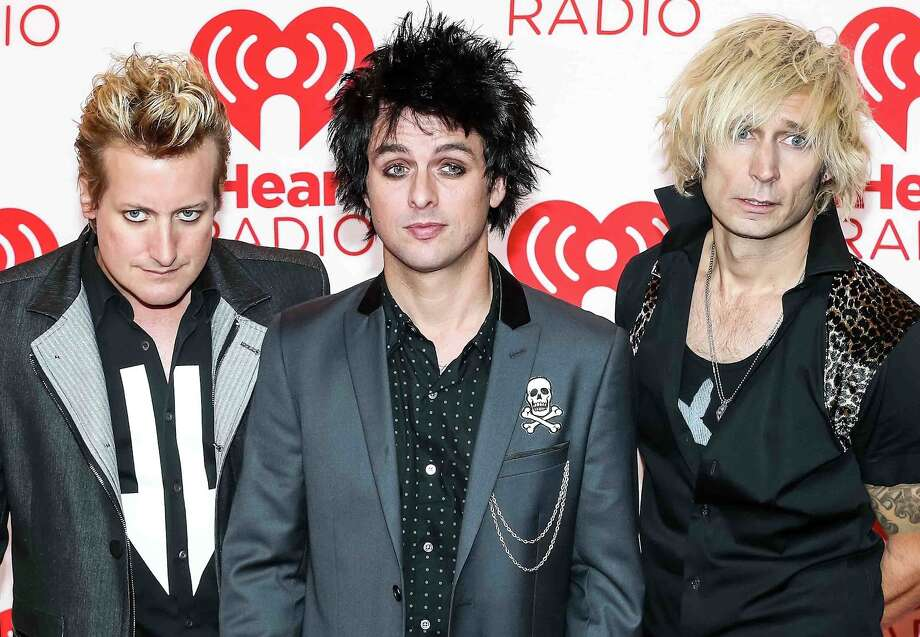 Green Day, 2012: Mike Dirnt, Billie Joe Armstrong and Tre Cool take their positions before the ill-fated set at the iHeartRadio Festival in Las Vegas.