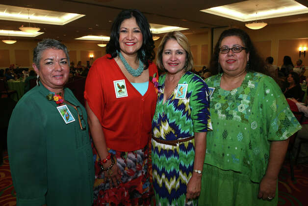 OTS/HEIDBRINK - Event co chairwoman Rosie Abreu, from left, Girl Scouts of SW Texas CEO Rose Gonzalez, Deborah Vasquez and silent auction chairwoman Leticia Luna gather at the Tardeada de Loteria fundraiser for the West Side Girl Scout Leadership Center at La Quinta Inn & Suites on 9/23/2012. names checked photo by leland a. outz Photo: LELAND A. OUTZ, SPECIAL TO THE EXPRESS-NEWS / SAN ANTONIO EXPRESS-NEWS