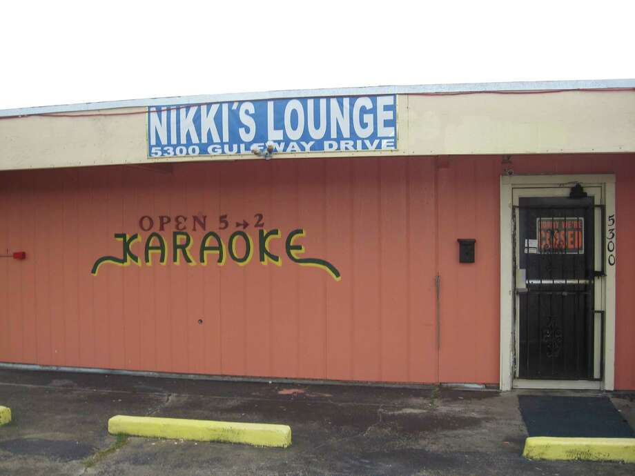 Nikki's Lounge, 5300 Gulfway Drive, Port Arthur, was the scene of a robbery-murder early Saturday in which bar owner Hieu Huynh was shot and killed by two assailants. Port Arthur police made one arrest and are searching for another. Dan Wallach/The Enterprise Photo: Dan Wallach