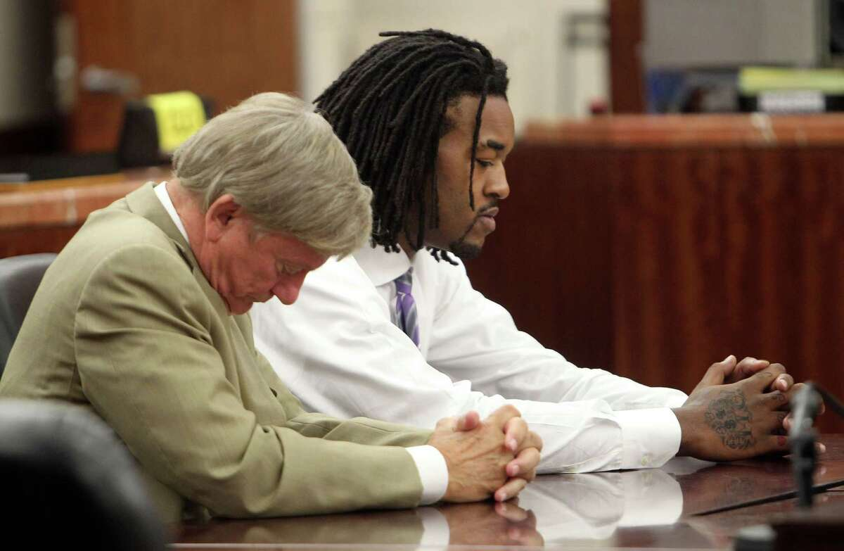The Los Angeles Lakers Jordan Hill right, his attorney Rusty Hardin left, in Judge Maria Jackson right, 339th District Criminal Court after Hill plead no contest to misdemeanor charge to an assault of a family member Thursday, Sept. 27, 2012, in Houston. ( James Nielsen / Chronicle )