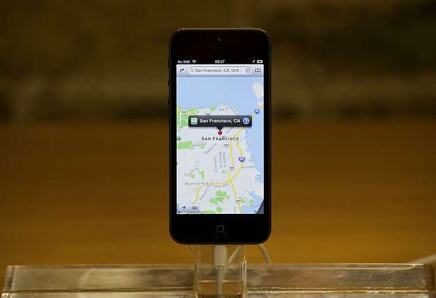 The new mapping app is displayed on an Apple Inc. iPhone 5 at the company's Covent Garden store in London, U.K., on Friday, Sept. 21, 2012. Apple Inc. is poised for a record iPhone 5 debut and may not be able to keep up with demand as customers lined up in Sydney, Tokyo, Paris and New York to pick up the latest model of its top-selling product. Photographer: Simon Dawson/Bloomberg Photo: Simon Dawson, Bloomberg