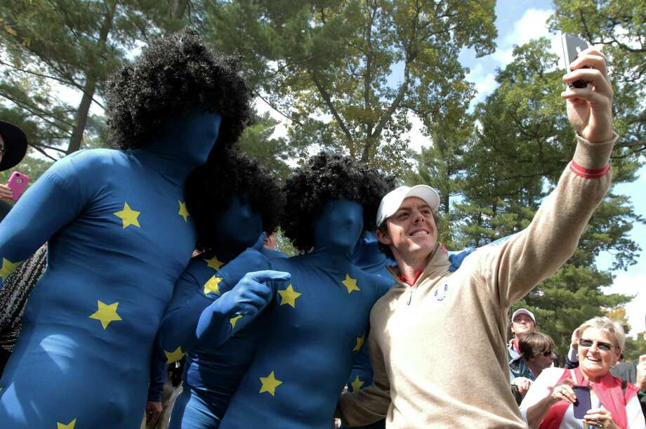 Europe's Rory McIlroy takes his pictures with some fans during a practice round at the Ryder Cup PGA golf tournament Thursday, Sept. 27, 2012, at the Medinah Country Club in Medinah, Ill. (AP Photo/Charlie Riedel) Photo: Charlie Riedel, Associated Press / AP