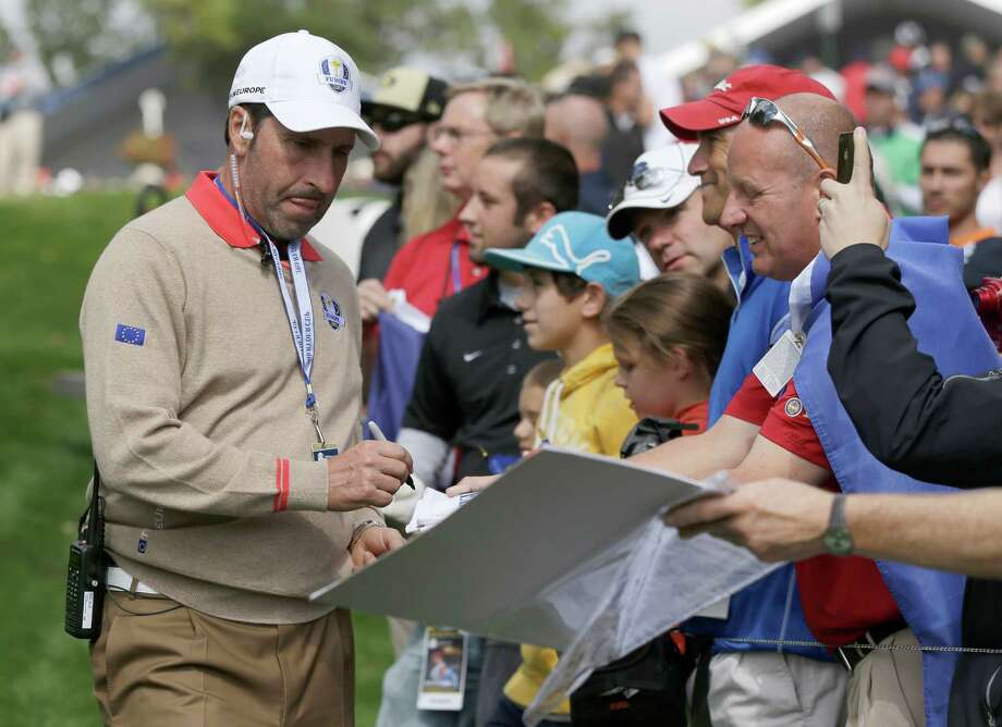 European team captain Jose Maria Olazabal signs autographs on the 14th hole during a practice round at the Ryder Cup PGA golf tournament Thursday, Sept. 27, 2012, at the Medinah Country Club in Medinah, Ill. (AP Photo/Chris Carlson) Photo: Chris Carlson, Associated Press / AP