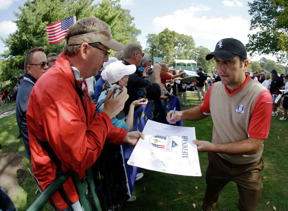 Europe's Francesco Molinari signs autographs during a practice round at the Ryder Cup PGA golf tournament Thursday, Sept. 27, 2012, at the Medinah Country Club in Medinah, Ill. (AP Photo/Chris Carlson) Photo: Chris Carlson, Associated Press / AP
