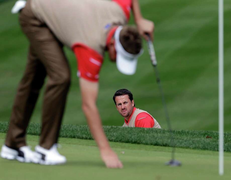 Europe's Graeme McDowell looks over a shot during a practice round at the Ryder Cup PGA golf tournament Thursday, Sept. 27, 2012, at the Medinah Country Club in Medinah, Ill. (AP Photo/Chris Carlson) Photo: Chris Carlson, Associated Press / AP