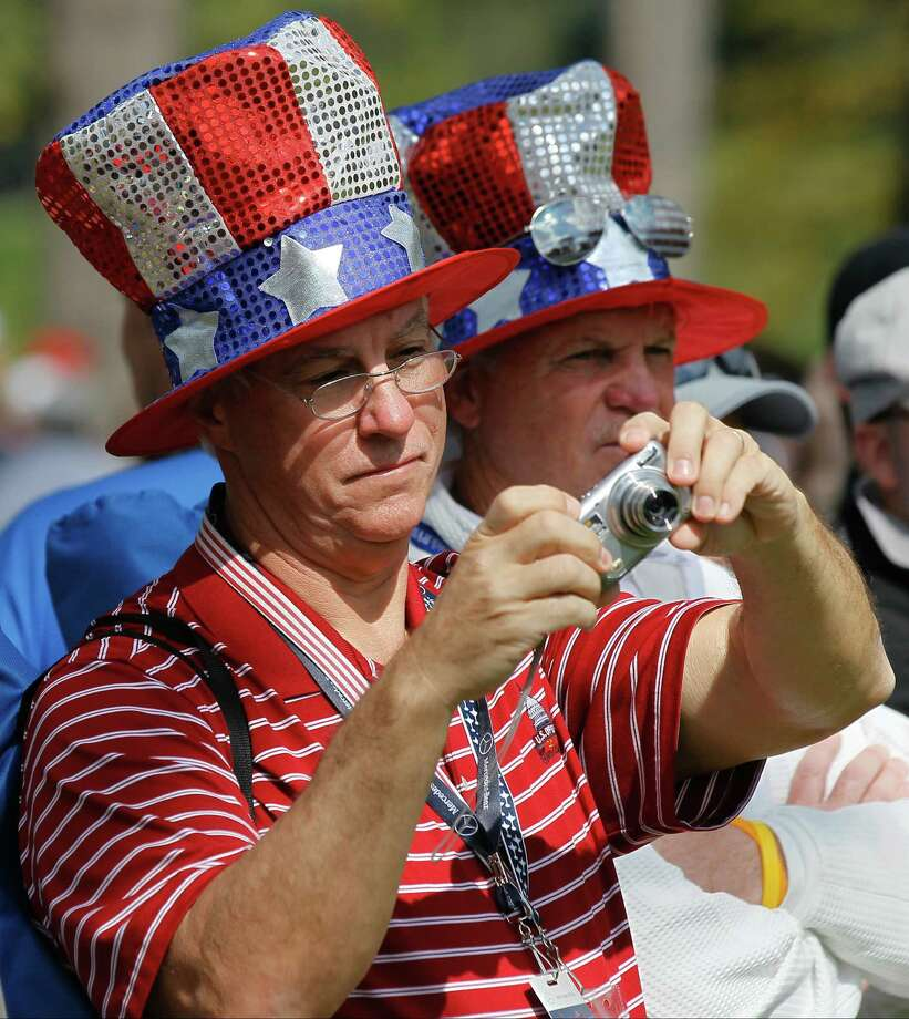 Fans take pictures during a practice round at the Ryder Cup PGA golf tournament Thursday, Sept. 27, 2012, at the Medinah Country Club in Medinah, Ill. (AP Photo/Charles Rex Arbogast) Photo: Charles Rex Arbogast, Associated Press / AP