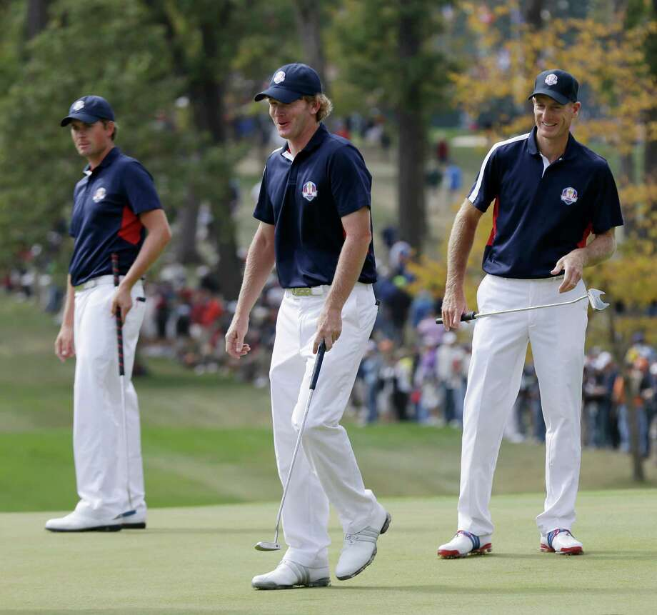 USA's Webb Simpson, left to right, Brandt Snedeker and Jim Furyk look over the green on the fourth hole during a practice round at the Ryder Cup PGA golf tournament Thursday, Sept. 27, 2012, at the Medinah Country Club in Medinah, Ill. (AP Photo/David J. Phillip) Photo: David J. Phillip, Associated Press / AP