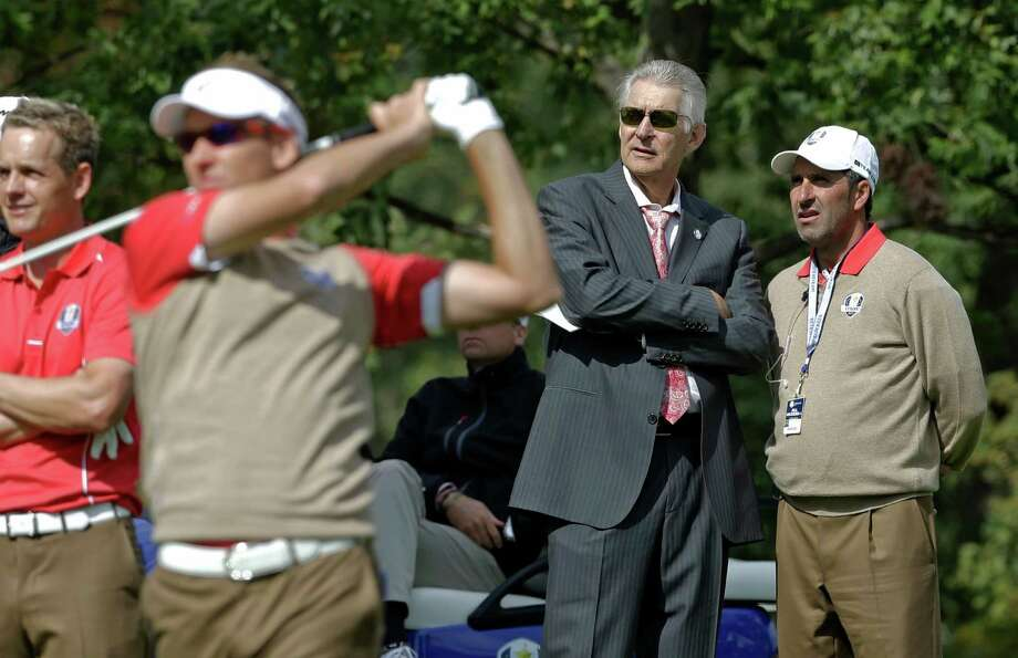 European team captain Jose Maria Olazabal talks to Andy North as his players tee off on the 14th hole during a practice round at the Ryder Cup PGA golf tournament Thursday, Sept. 27, 2012, at the Medinah Country Club in Medinah, Ill. (AP Photo/Chris Carlson) Photo: Chris Carlson, Associated Press / AP