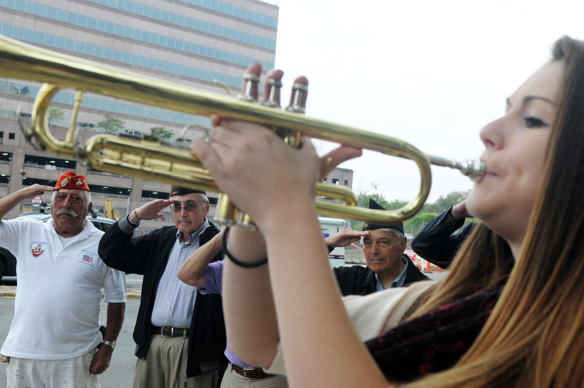 Westhill High School student Kayla McCabe performs Taps as, from left, Pat Battinelli, Sherwin Baer and Jack Halpert salute as Mayor Michael Pavia and the Stamford Jewish War Veterans hold a rededication ceremony of Tresser Boulevard, which was named in honor of the Private Samuel Tresser, outside the Government Center in Stamford, Conn., Sept. 27, 2012. Tresser enlisted in the Old Seventh Company, Connecticut Artillery Company, on May 13, 1915. He was killed in action at the Battle of St. Mihiel during World War 1 on August 24, 1918.