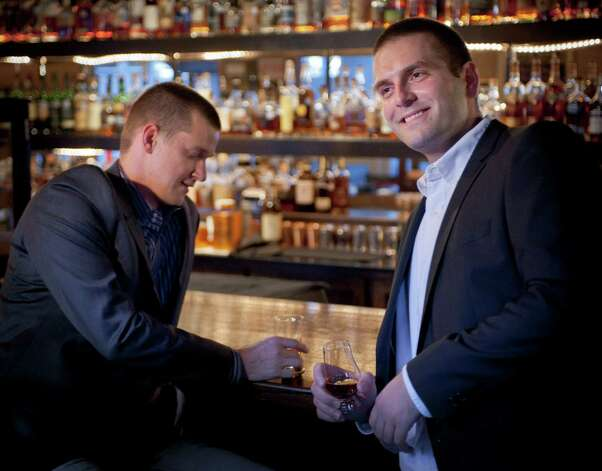 Distillery owners Boyan Kalusevic, right, and Chris Mobley, pose for a photograph, Wednesday, Sept. 26, 2012, at Bar 1919 in San Antonio. Photo: Darren Abate, Darren Abate/For The Express-New