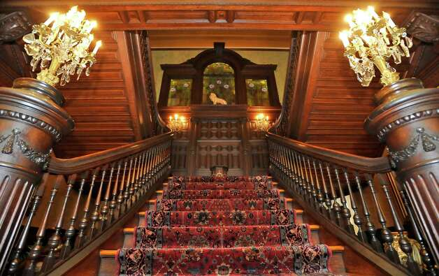 This is the Grand Staircase that goes to the second floor. Visitors can put their hands on the ornate woodwork as the go up the stairs. The McFaddin-Ward House was built in 1905-1906. The home is a Beaux-Arts Colonial style dwelling and the McFaddins moved into it in January of 1907. The home reflects the lifestyle of the McFaddins who lived in the home for 75 years.  Today, visitors to the home will receive a guided tour of all three floors and can even look in the bathrooms and some closets while hearing stories about the family and the house.Dave Ryan/The Enterprise Photo: Billy Calzada