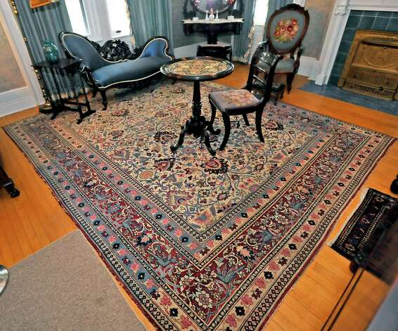 When visitors tour the home, they have to stay on specific carpet runners when they enter a room, some of the following photographs are of items in said rooms, but not easily seen from the walking tour vantage point. One exception is in the Blue Bedroom where the runner, left, stops at the edge of the 1864 Persian Rug.  The McFaddin-Ward House was built in 1905-1906. The home is a Beaux-Arts Colonial style dwelling and the McFaddins moved into it in January of 1907. The home reflects the lifestyle of the McFaddins who lived in the home for 75 years.  Today, visitors to the home will receive a guided tour of all three floors and can even look in the bathrooms and some closets while hearing stories about the family and the house.Dave Ryan/The Enterprise Photo: Billy Calzada