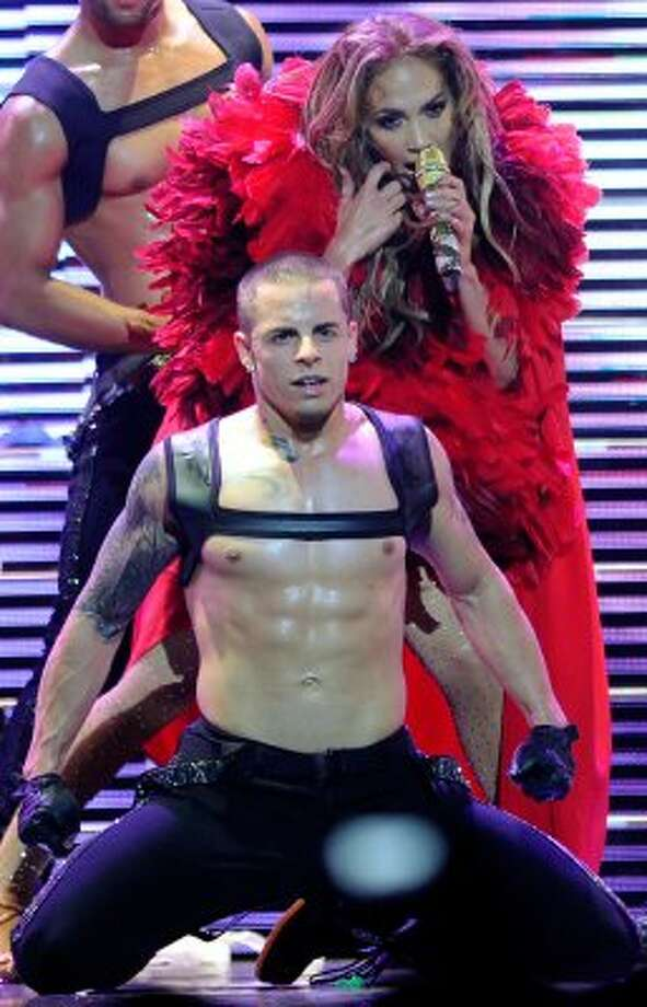 Jennifer Lopez, 42, and dancer boyfriend, Casper Smart, 24, performing at the iHeartRadio Music Festiva in Las Vegas last September.  (Ethan Miller / Getty Images for Clear Channel)