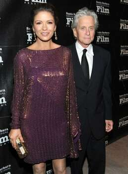 Catherine Zeta-Jones, 42, with husband Michael Douglas, 67, at SBIFF's Kirk Douglas Award for Excellence In Film honoring Michael Douglas last October. (Michael Buckner / Getty Images)