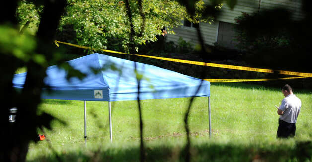 A blue tent protects the scene of a fatal shooting on Meeting House Hill Circle. Sources say a man shot his son, who was allegedly breaking into a relative's house. Photo: Carol Kaliff
