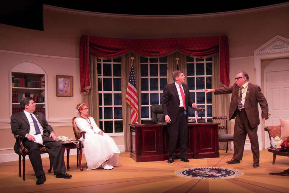 "Left to right in a scene from ""November"" are Tom Libonate as President Charles H.P. Smith, Robyn Maitland as Clarice Bernstein, Jonathan Jacobson as Archer Brown, and Mike Ritts as ""The Turkey Guy."" The show runs through Oct. 6 in New Milford. Photo: Contributed Photo"