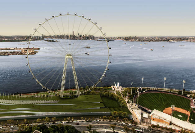 "In this image released by the New York Mayor's Office on Thursday, is an artist's rendering of a proposed 625-foot Ferris wheel, billed as the world's largest, planned as part of a retail and hotel complex along the Staten Island waterfront in New York. The attraction, called the New York Wheel, will cost $230 million. Officials say the observation wheel will be higher than the Singapore Flyer, the London Eye, and a ""High Roller"" wheel planned in Las Vegas. Beyond the wheel is the Manhattan skyline. On the lower right is the Richmond County Bank Ballpark, home of the Staten Island Yankees. (AP Photo/Office of the Mayor of New York) Photo: Associated Press"