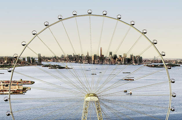 "In this image released by the New York Mayor's Office, Thursday is an artist's rendering of a proposed 625-foot Ferris wheel, billed as the world's largest, planned as part of a retail and hotel complex along the Staten Island waterfront in New York. The attraction, called the New York Wheel, will cost $230 million. Officials say the observation wheel will be higher than the Singapore Flyer, the London Eye, and a ""High Roller"" wheel planned in Las Vegas. Beyond the wheel is the Manhattan skyline. (AP Photo/Office of the Mayor of New York) Photo: Associated Press"
