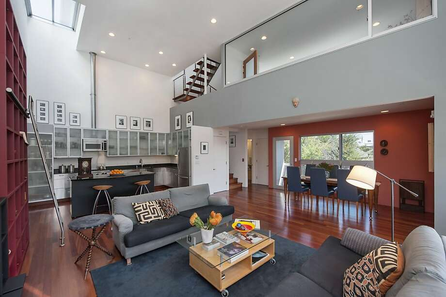 The contemporary loft condo spans 1,575 square feet and includes two bedrooms. It's listed for $749,000. Photo: Thomas Grubba