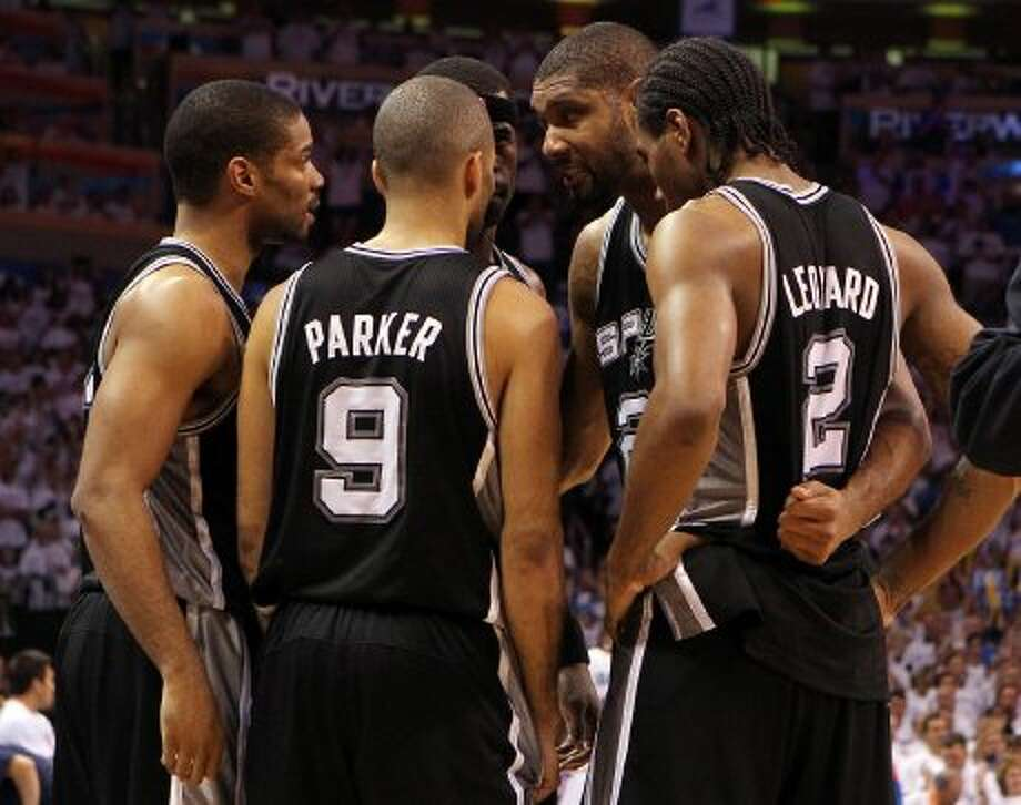 Was standing pat the right move?The Spurs' decision to go with essentially the same team that, depending on your point of view, was either two games from the Finals or reverse swept off the court by Oklahoma City has been debated all summer.On paper, it looks to be a typically sound, safe choice from the Spurs. But with the Lakers having loaded up and the Thunder not going anywhere, only time will tell if it was the right choice. (Kin Man Hui / San Antonio Express-News)
