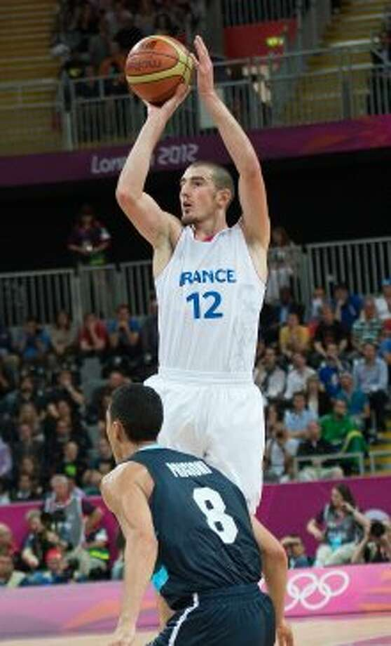 Can Nando De Colo contribute?From watching the Olympics or any of his many video mixes floating around on YouTube, it's clear that De Colo is a smart player who understands the game. With a good IQ wrapped in the package of a solid 6-5 frame, that's a solid foundation to build around.The problem seems to be the execution, where De Colo's limited athleticism isn't always ready to pull of what his brain is telling him. The Spurs don't need him to contribute right away, which should aid his learning curve. But they might not be able to allot much playing time to a project while they pursue another championship. (Harry E. Walker / McClatchy-Tribune News Service)