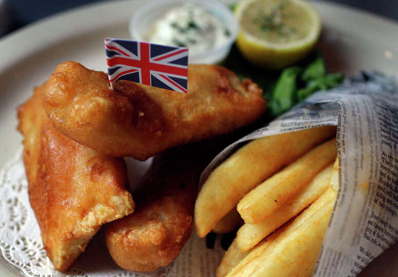 Fish and chips are a popular menu item at mad dogs british for Best fish and chips in san diego