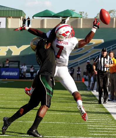 Baylor defensive back Demetri Goodson (3) breaks up a pass intended for Southern Methodist wide receiver Der'rikk Thompson (7) during the first half of an NCAA college football game in Waco, Texas, Sunday, Sept. 2, 2012. (AP Photo/LM Otero) Photo: LM Otero, Associated Press / AP
