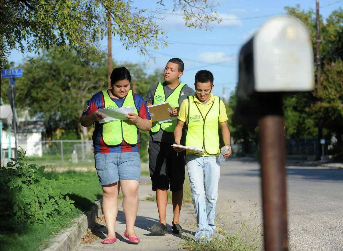 Johana Deleon, left, Gilbert Mejia and Carlos Mendez, who each was brought into the United States by illegal immigrant parents, canvas a South San Antonio neighborhood in search of registered voters willing to pledge to vote for political candidates that support the Dream Act, on Wednesday, Sept. 26, 2012. The Dream Act would gives some undocumented immigrants brought to the United States as children a path toward legal status. Wednesday, Sept. 26, 2012.