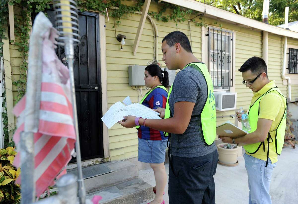 Johana Deleon, left, Gilbert Mejia and Carlos Mendez, each of who was brought into the United States by illegal immigrant parents, canvas a South San Antonio neighborhood in search of registered voters willing to pledge to vote for political candidates that support the Dream Act, on Wednesday, Sept. 26, 2012. The Dream Act would gives some undocumented immigrants brought to the United States as children a path toward legal status. Wednesday, Sept. 26, 2012.